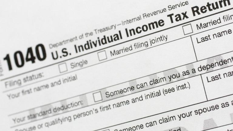 This July 24, 2018, file photo shows a portion of the 1040 U.S. Individual Income Tax Return form. The Trump administration is working on plans to delay the April 15 federal tax deadline for most individual taxpayers as well as small businesses. (AP Photo / Mark Lennihan, File)