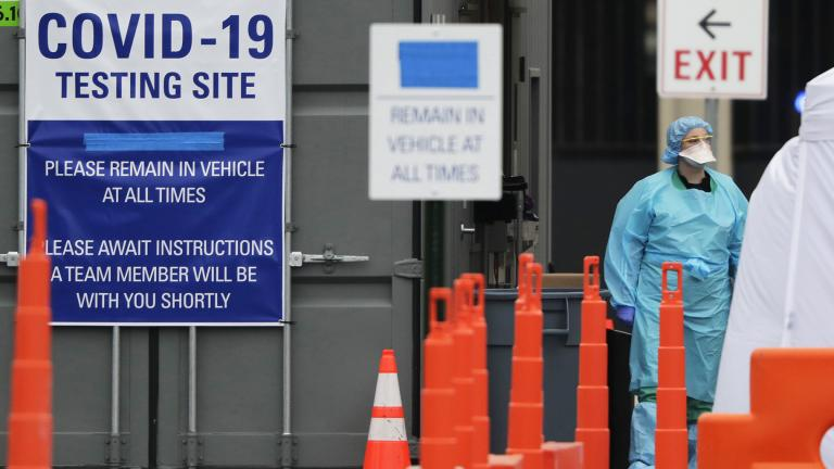 In this Thursday, March 19, 2020 file photo, medical personnel conduct drive-through COVID-19 coronavirus testing at a hospital in Park Ridge, Ill. (AP Photo / Nam Y. Huh)