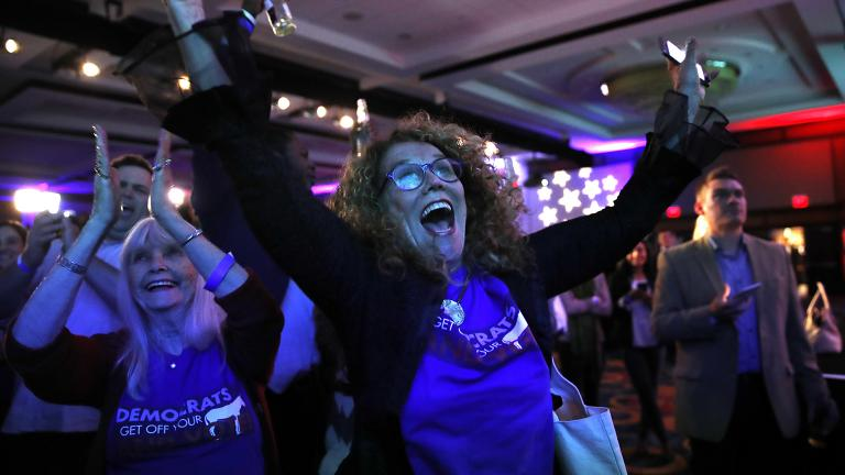 Sydney Crawford, 84, left, of New York City, and JoAnn Loulan, 70, of Portola Valley, Calif., watch election returns during a Democratic party election night event at the Hyatt Regency Hotel, on Tuesday, Nov. 6, 2018, in Washington. (AP Photo / Jacquelyn Martin)