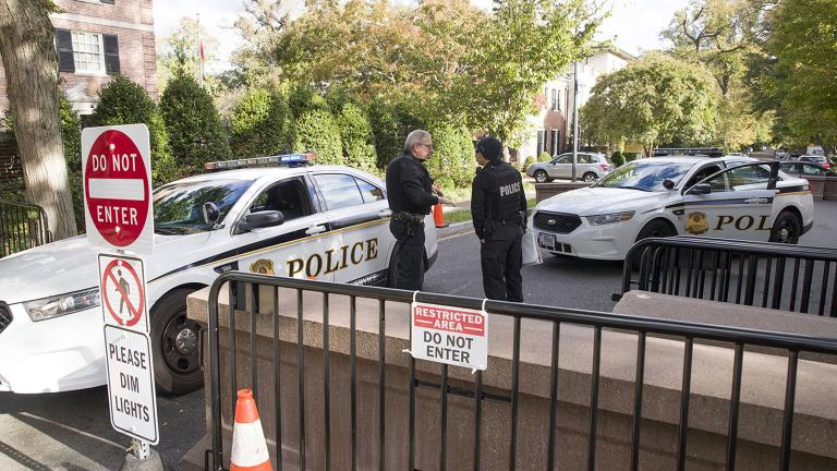 Officers with the Uniform Division of the United States Secret Service talk at a checkpoint near the home of former President Barack Obama on Wednesday, Oct. 24, 2018, in Washington, D.C. (AP Photo / Alex Brandon)