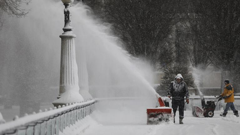 Snow-clearing efforts at Millennium Park following a snow storm on Saturday, Jan. 19, 2019. (Abel Uribe / Chicago Tribune via AP)