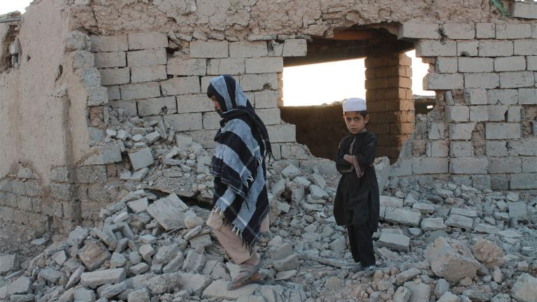 Afghan boys walk near a damaged house after airstrikes in two weeks ago during a fight between government forces and the Taliban in Lashkar Gah, Helmand province, southwestern, Afghanistan, Saturday, Aug. 21, 2021. (AP Photo / Abdul Khaliq)