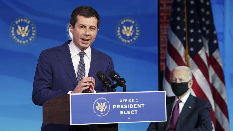 Former South Bend, Ind. Mayor Pete Buttigieg, President-elect Joe Biden's nominee to be transportation secretary reacts to his nomination as Biden looks on during a news conference at The Queen theater in Wilmington, Del., Wednesday, Dec. 16, 2020. (Kevin Lamarque / Pool via AP)