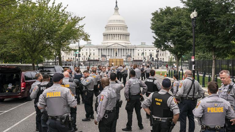 Police stage at a security fence ahead of a rally near the U.S. Capitol in Washington, Saturday, Sept. 18, 2021.  (AP Photo / Nathan Howard)