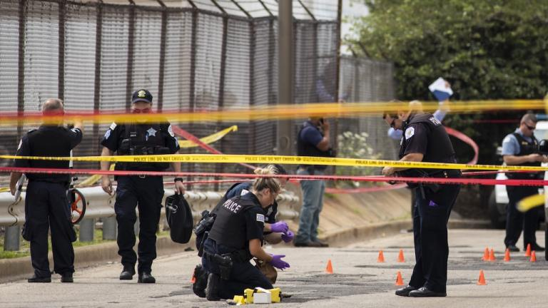 Chicago Police investigate at the 25th District station on the Northwest Side, after several officers were shot outside the station, Thursday, July 30, 2020. (Ashlee Rezin Garcia/Chicago Sun-Times)