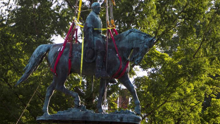 Workers remove the monument of Confederate General Robert E. Lee on Saturday, July 10, 2021 in Charlottesville, Va. The removal of the Lee statue follows years of contention, community anguish and legal fights. (AP Photo / John C. Clark)