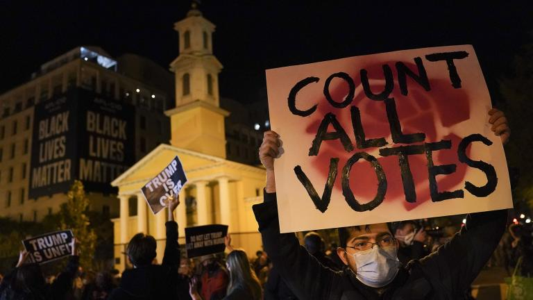 A demonstrator holds up a sign while waiting for election results at Black Lives Matter Plaza, Tuesday, Nov. 3, 2020, in Washington. (AP Photo / John Minchillo)