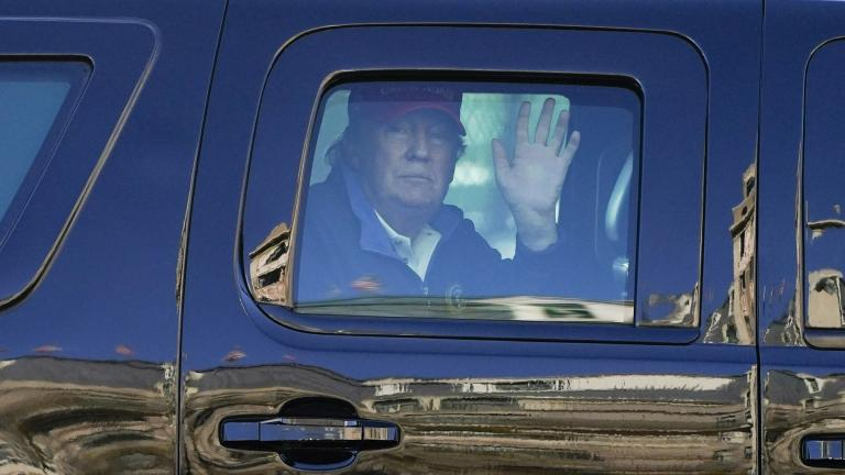 President Donald Trump waves to supporters from his motorcade as people gather for a march Saturday, Nov. 14, 2020, in Washington. (AP Photo / Julio Cortez)