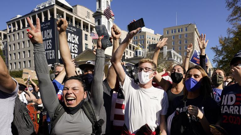 People gathered in Black Lives Matter Plaza react to the presidential race being called by CNN in Democratic presidential candidate Joe Biden's favor over Pres. Donald Trump to become the 46th president of the United States, Saturday, Nov. 7, 2020, in Washington. (AP Photo / Alex Brandon)