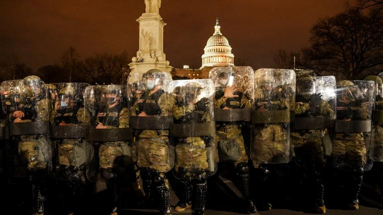 District of Columbia National Guard stand outside the Capitol, Wednesday night, Jan. 6, 2021, after a day of rioting protesters. (AP Photo / John Minchillo)