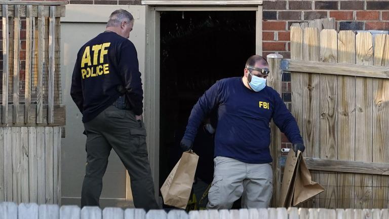 Investigators remove items from the basement of a home Saturday, Dec. 26, 2020, in Nashville, Tenn. (AP Photo / Mark Humphrey)