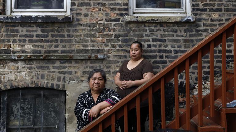Maria Elena Estamilla, 62, left and her daughter Esmeralda Triquiz pose for a photo June 30, 2021, in Chicago's Pilsen neighborhood. (AP Photo / Shafkat Anowar)