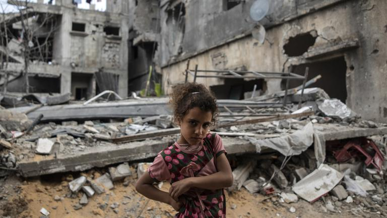 Palestinian Rahaf Nuseir, 10, looks on as she stands in front of her family's destroyed homes, to which they returned following a cease-fire reached after an 11-day war between Gaza's Hamas rulers and Israel, in town of Beit Hanoun, northern Gaza Strip, Friday, May 21, 2021. (AP Photo / Khalil Hamra)