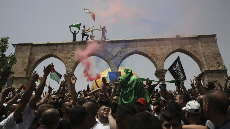 Palestinians wave national flags in front of the Dome of the Rock in the al-Aqsa mosque complex in Jerusalem, Friday, May 21, 202, as a cease-fire took effect between Hamas and Israel after an 11-day war. (AP Photo / Mahmoud Illean)