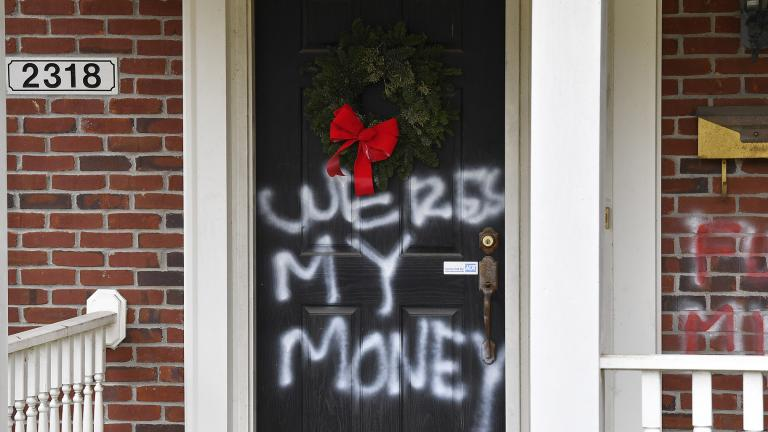 "Graffiti reading, ""Where's my money"" is seen on a door of the home of Senate Majority Leader Mitch McConnell, R-Ky., in Louisville, Ky., on Saturday, Jan. 2, 2021. (AP Photo /T imothy D. Easley)"