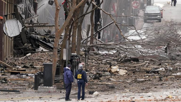 Emergency personnel work near the scene of an explosion in downtown Nashville, Tenn., Friday, Dec. 25, 2020. Buildings shook in the immediate area and beyond after a loud boom was heard early Christmas morning.(AP Photo / Mark Humphrey)