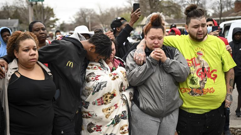 Family and friends of Daunte Wright, 20, grieve at 63rd Avenue North and Lee Avenue North hours after they say he was shot and killed by police, Sunday, April 11, 2021, in Brooklyn Center, Minn. Wright's mother, Katie Wright, stands at center. (Aaron Lavinsky / Star Tribune via AP)