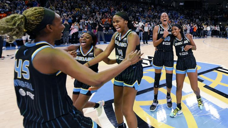 Chicago Sky players celebrate after defeating the Connecticut Sun 79-69 in Game 4 of a WNBA basketball playoff semifinal, Wednesday, Oct. 6, 2021, in Chicago. (AP Photo / Paul Beaty)