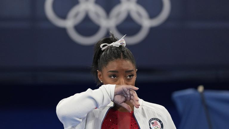 Simone Biles, of the United States, watches gymnasts perform after an apparent injury, at the 2020 Summer Olympics, Tuesday, July 27, 2021, in Tokyo. Biles withdrew from the team finals. (AP Photo / Ashley Landis)