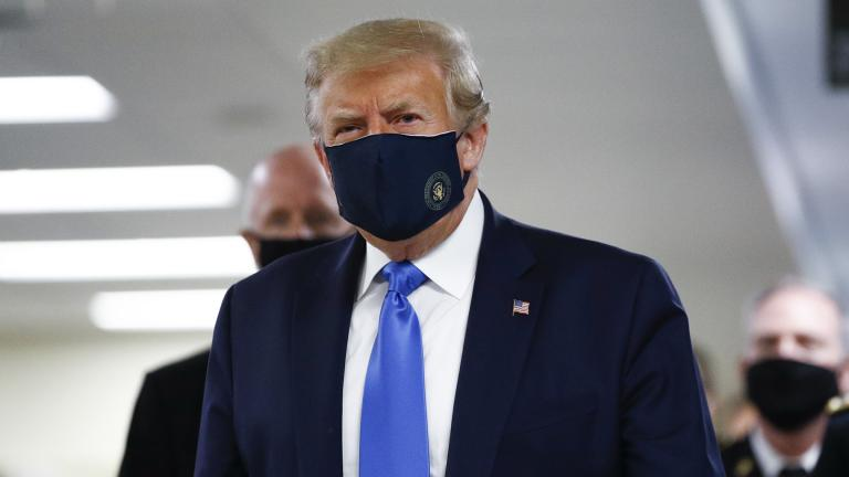 President Donald Trump wears a mask as he walks down the hallway during his visit to Walter Reed National Military Medical Center in Bethesda, Md., Saturday, July 11, 2020. (AP Photo / Patrick Semansky)