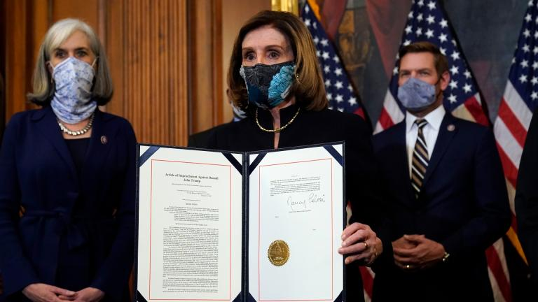 House Speaker Nancy Pelosi of Calif., displays the signed article of impeachment against President Donald Trump in an engrossment ceremony before transmission to the Senate for trial on Capitol Hill, in Washington, Wednesday, Jan. 13, 2021. (AP Photo / Alex Brandon)