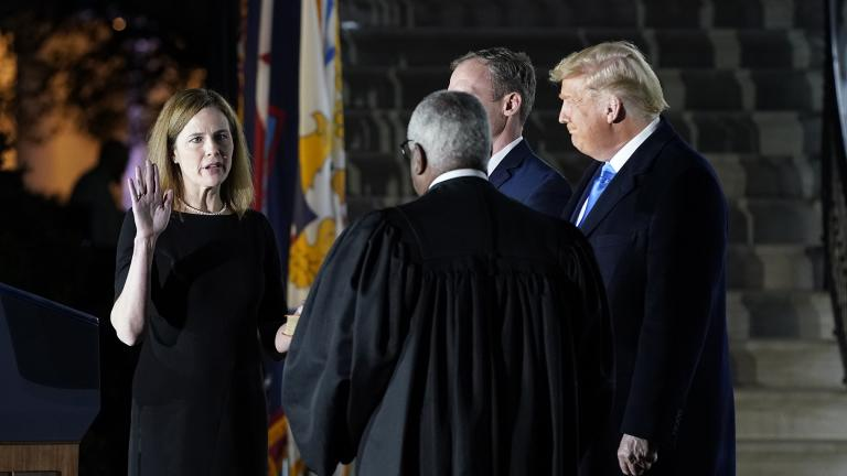 President Donald Trump watches as Supreme Court Justice Clarence Thomas administers the Constitutional Oath to Amy Coney Barrett on the South Lawn of the White House in Washington, Monday, Oct. 26, 2020, after Barrett was confirmed by the Senate earlier in the evening. (AP Photo / Patrick Semansky)