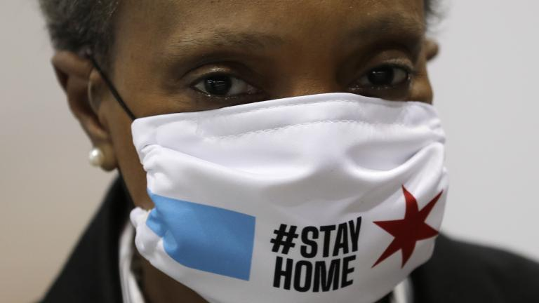 """Chicago Mayor Lori Lightfoot wears a mask as she attends a news conference in Hall A of the COVID-19 alternate site at McCormick Place in Chicago, Friday, April 10, 2020. The """"alternative care facility"""" is designed to relieve pressure on city hospitals from rapidly mounting COVID-19 cases. (AP Photo/Nam Y. Huh)"""