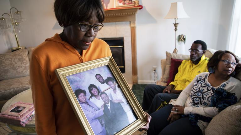 Glenda O'Neal, mother of Dr. Tamara O'Neal, shows a photo of her family at their home in LaPorte, Ind., Tuesday, Nov. 20, 2018. Dr. O'Neal was one of the three people fatally shot Monday at Mercy Hospital. (Zbigniew Bzdak / Chicago Tribune via AP)