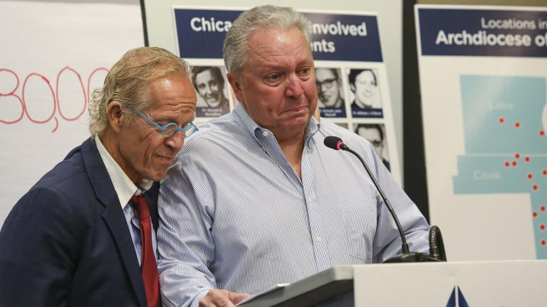 Jeff Anderson, an attorney for victims of sexual abuse by clergy, is joined by abuse victim Joe Iacono as he speaks during a press conference in Chicago, Sept. 17, 2019. (AP Photo / Teresa Crawford)