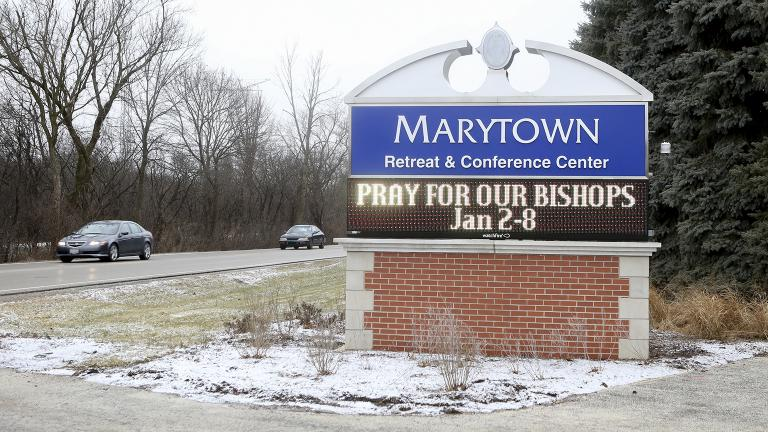 A sign outside the Mundelein Seminary asks the faithful to pray for U.S.-based Roman Catholic bishops gathering there for a weeklong prayer retreat, Wednesday, Jan. 2, 2019, in Mundelein, Illinois. (AP Photo / Teresa Crawford)