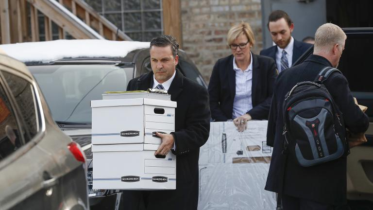 Investigators carry boxes away from Ald. Ed. Burke's 14th Ward office on the city's Southwest Side on Thursday, Nov. 29, 2018. (Jose M. Osorio / Chicago Tribune via AP)