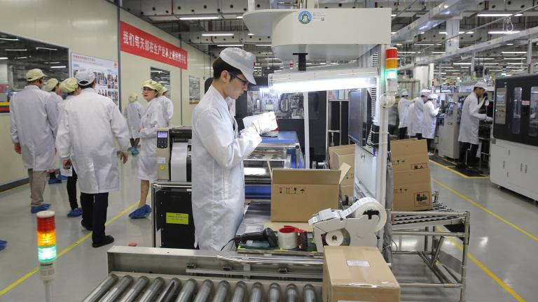 In this March 6, 2019, file photo a staff member works on a mobile phone production line during a media tour in Huawei factory in Dongguan, China's Guangdong province. Huawei Technologies Co. is one of the world's biggest supplier of telecommunications equipment. (AP Photo / Kin Cheung, File)