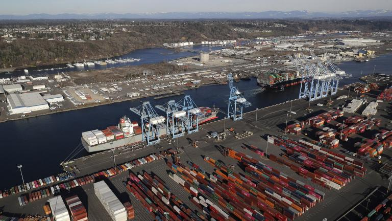 In this March 5, 2019, file photo, cargo containers are staged near cranes at the Port of Tacoma, in Tacoma, Washington. (AP Photo / Ted S. Warren, File)