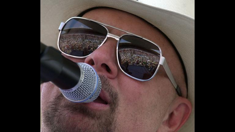 In this June 12, 2000 file photo, country music fans are reflected in the glasses of Southern rock group Confederate Railroad lead singer Danny Shirley during a concert in Nashville, Tennessee. (AP Photo / Mark Humphrey)