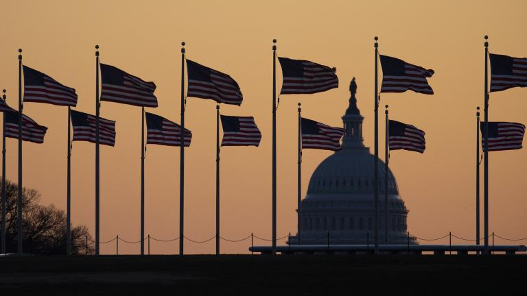 American flags blow in wind around the Washington Monument with the U.S. Capitol in the background at sunrise on Monday, Jan. 20, 2020, in Washington. The impeachment trial of President Donald Trump will resume in the U.S. Senate on Jan. 21.  (AP Photo / Jon Elswick)