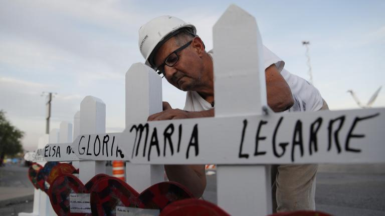 In this Aug. 5, 2019, file photo Greg Zanis prepares crosses to place at a makeshift memorial for victims of a mass shooting at a shopping complex in El Paso, Texas. (AP Photo / John Locher, File)