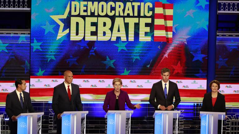 Democratic presidential candidate Sen. Elizabeth Warren, D-Mass., center, answers a question, during the Democratic primary debate hosted by NBC News at the Adrienne Arsht Center for the Performing Art, Wednesday, June 26, 2019, in Miami. Listening from left are, former Housing and Urban Development Secretary Julian Castro, Sen. Cory Booker, D-N.J., former Texas Rep. Beto O'Rourke, and Sen. Amy Klobuchar, D-Minn. (AP Photo / Wilfredo Lee)