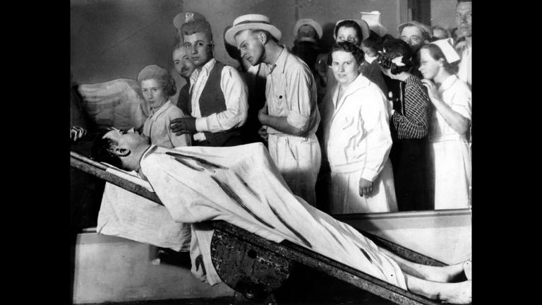 In this December 1934 file photo, people view the body of gangster John Dillinger in a Chicago morgue. (AP Photo / File)