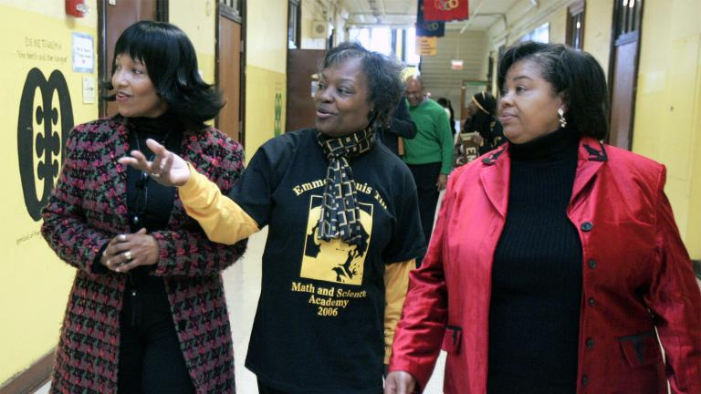 In this Feb 24, 2006, file photo, Deborah Watts, left, and Ollie Gordon, right, both cousins of Emmett Till, accompany Principal Mary Rogers as they walk through a hallway at Emmett Louis Till Math & Science Academy, in Chicago, honoring the 14-year-old former student. Till's lynching galvanized the civil rights movement. (AP Photo / M. Spencer Green, File)