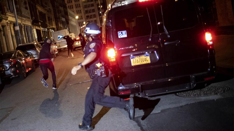 FILE - In this June 1, 2020, file photo, a protester runs as he is chased by police in New York. A grim video of a Chicago police officer fatally shooting a 13-year-old boy is once again shining a light on the policies that govern foot chases. (AP Photo / Wong Maye-E, File)