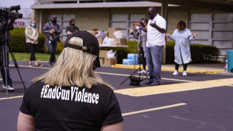A woman wears a shirt calling for the end of gun violence during a vigil at the Olivet Missionary Baptist Church for the victims of the shooting at a FedEx facility in Indianapolis, Saturday, April 17, 2021. A gunman killed eight people and wounded several others before taking his own life in a late-night attack at a FedEx facility near the Indianapolis airport, police said. (AP Photo / Michael Conroy)