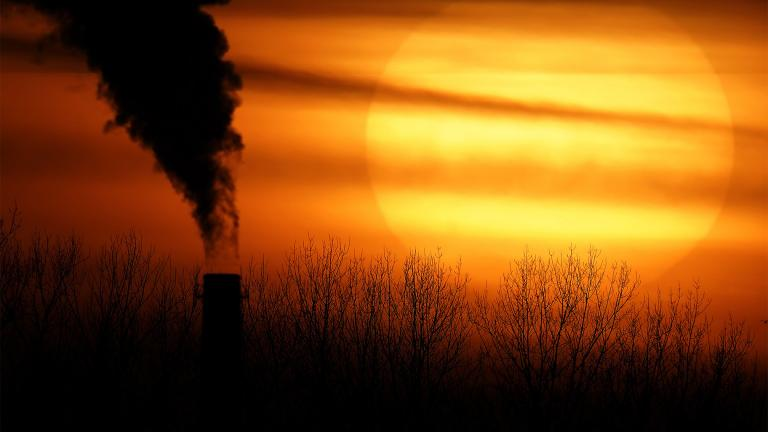 In this Feb. 1, 2021 file photo, emissions from a coal-fired power plant are silhouetted against the setting sun in Independence, Mo. (AP Photo / Charlie Riedel, File)