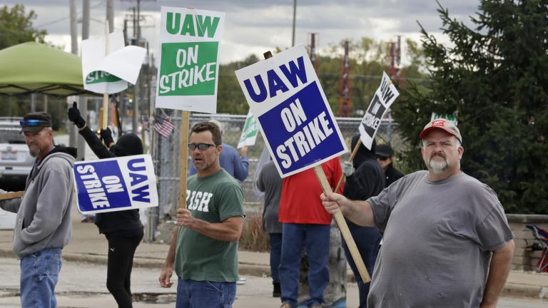 John Kirk, right, a 20-year-employee, pickets with co-workers outside the General Motors Fabrication Division, Friday, Oct. 4, 2019, in Parma, Ohio. (AP Photo / Tony Dejak)