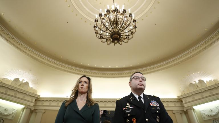 Jennifer Williams, an aide to Vice President Mike Pence, and National Security Council aide Lt. Col. Alexander Vindman stand as they take a break in hearing before the House Intelligence Committee on Capitol Hill in Washington, Tuesday, Nov. 19, 2019. (AP Photo / Andrew Harnik)