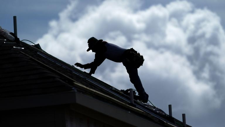 A roofer works on a new home under construction Thursday, July 18, 2019, in Houston. A heat wave is expected to send temperatures soaring close to 100 degrees through the weekend across much of the country. (AP Photo / David J. Phillip)