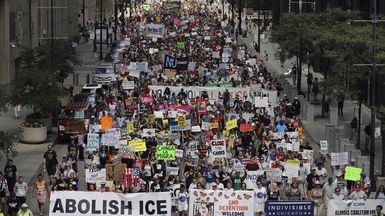 Thousands of people, including immigrants and their supporters, rally against President Donald Trump's immigration policies as they march from Daley Plaza to the Chicago field office of Immigration and Customs Enforcement, Saturday, July 13, 2019, in Chicago. (Abel Uribe / Chicago Tribune via AP)