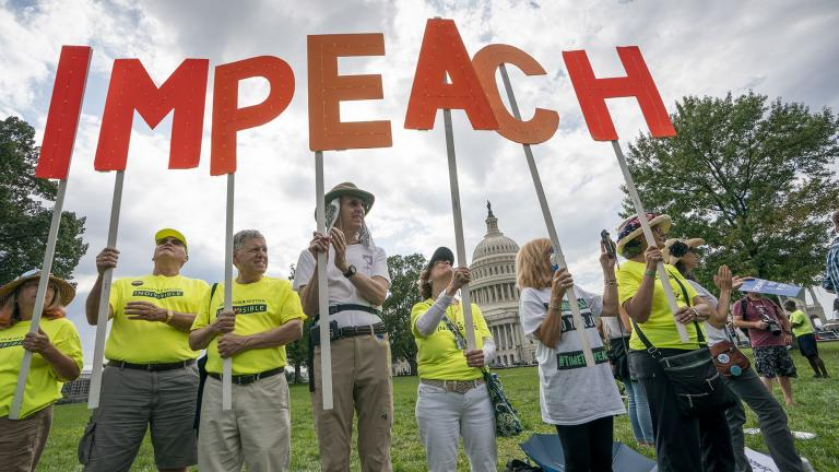 Activists rally for the impeachment of President Donald Trump at the Capitol in Washington on Thursday, Sept. 26, 2019. (AP Photo / J. Scott Applewhite)