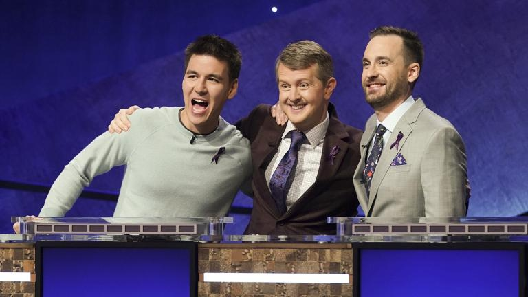 "In this image released by ABC, contestants, from left, James Holzhauer, Ken Jennings and Brad Rutter appear on the set of ""Jeopardy! The Greatest of All Time,"" in Los Angeles. (Eric McCandless / ABC via AP)"
