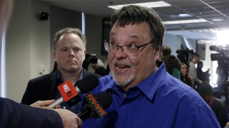 Former Chicago Sun-Times reporter Jim DeRogatis talks to Chicago Tonight and other reporters after a news conference by Cook County State's Attorney Kim Foxx announcing charges against R. Kelly, the R&B star, with 10 counts of aggravated sexual abuse involving multiple victims in Chicago. (AP Photo / Kiichiro Sato)