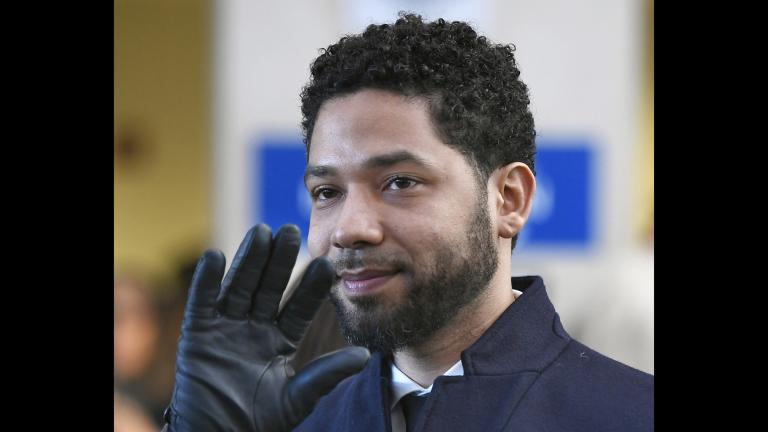In this March 26, 2019, file photo, actor Jussie Smollett smiles and waves to supporters before leaving Cook County Court. (AP Photo / Paul Beaty, File)